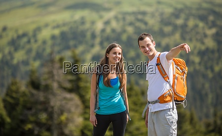 pretty young woman hiking outdoors in