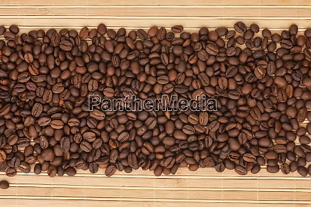 coffee beans lying on a bamboo