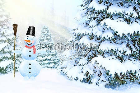 jolly snowman among new year trees