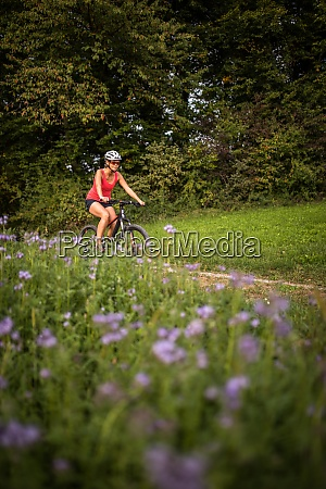 pretty young woman riding her mountain