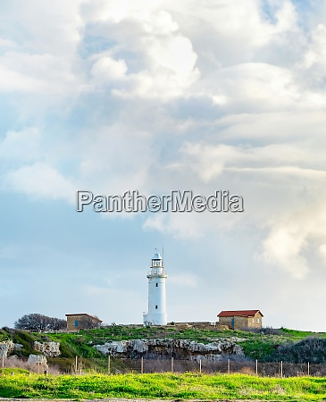 clouds lighthouse seaside