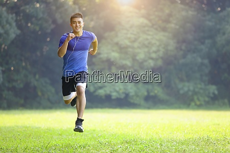 young man in fitness wear and