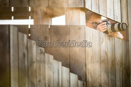 pretty female photographer in a hide