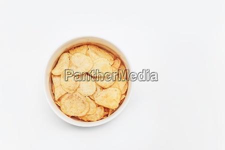 crispy potato chips in bowl on