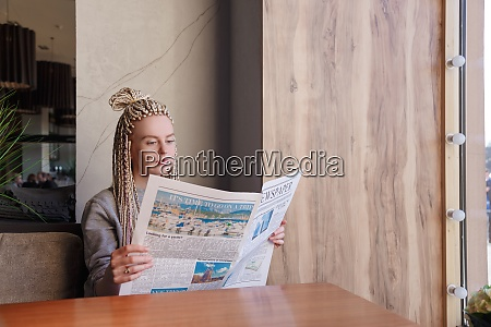 attractive young hipster woman reading a