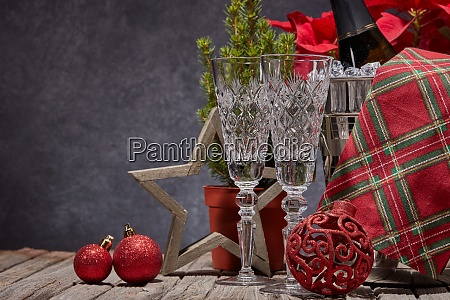 red poinsettia flowers champagne bottle empty
