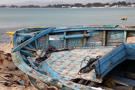 damaged ship on the beach