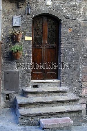 wooden door with a stone door