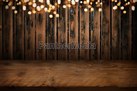 board wall with wooden table and