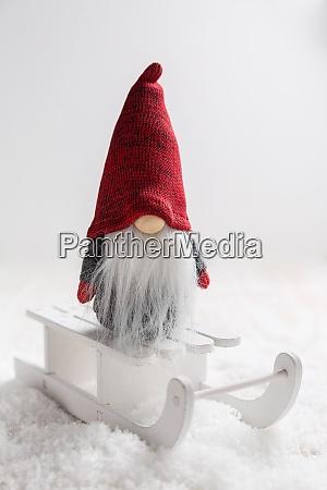christmas imp on sleigh with snowy