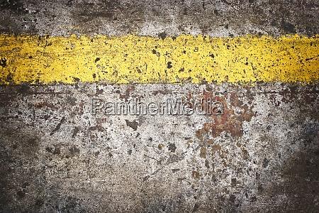 grunge floor with yellow line