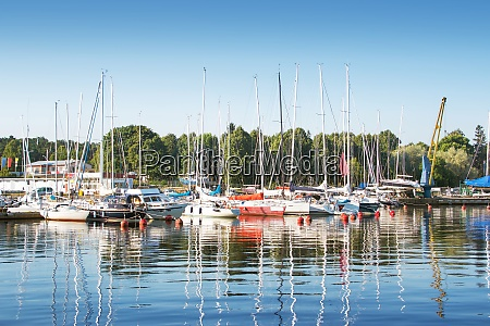 yachts at pier in sunny morning