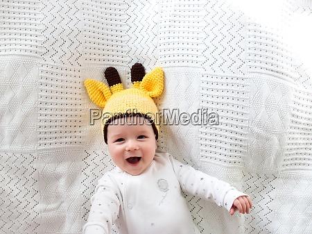 baby in giraffe hat