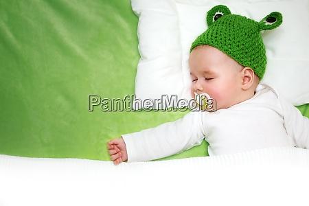 baby on green blanket