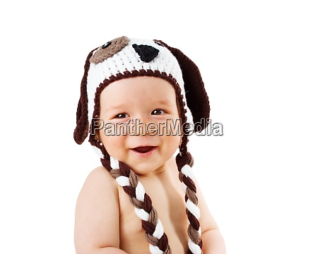 baby in dog hat smiling isolated