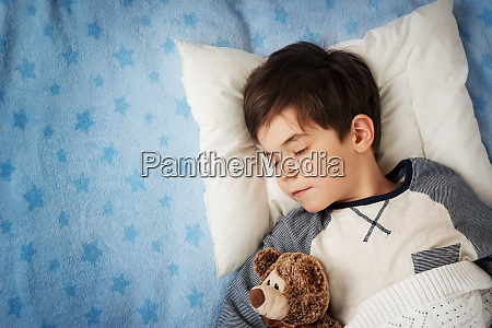 six years old child sleeping in