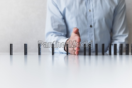 man prevent of domino falling social