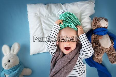 ill boy lying in bed