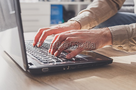 freelancer young man working on laptop