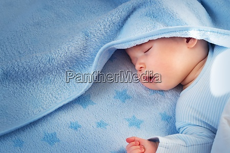 three month old baby sleeping on