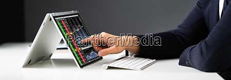 stock exchange business analyst using computer