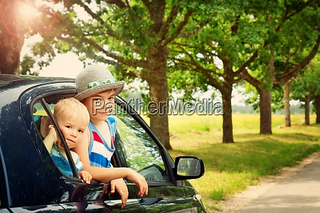 children looking out of window from