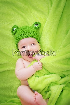 baby in frog hat