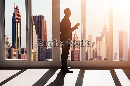 african businessman viewing city downtown