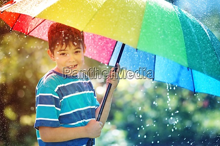 child walking on rainy weather