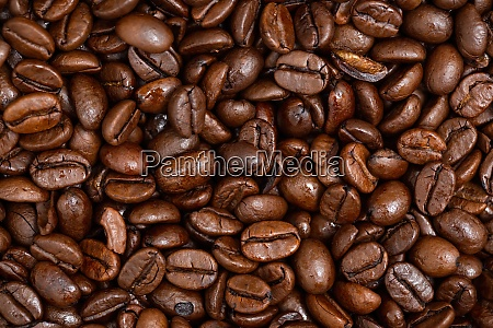 roasted dark coffee beans background from