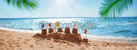 sandcastle on the blue sea in