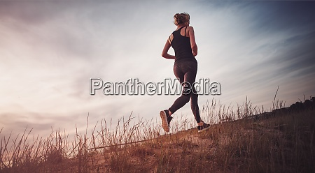 young woman running on the field