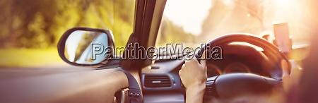 driver driving a car on asphalt