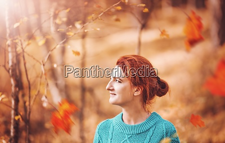 pretty woman with red hair in