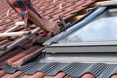 roofer with skylight close up