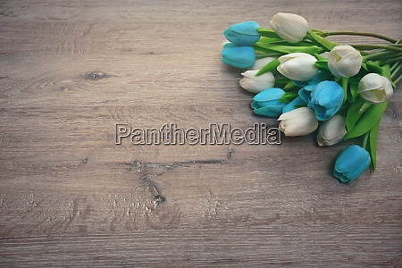 bouquet of tulips on a wooden