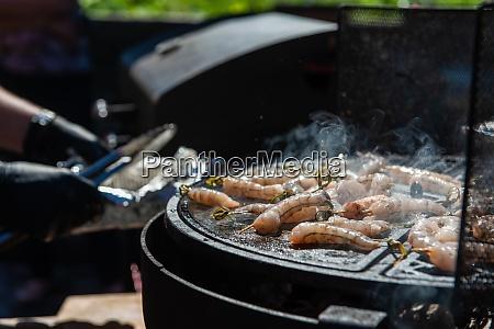 a professional cook prepares shrimps