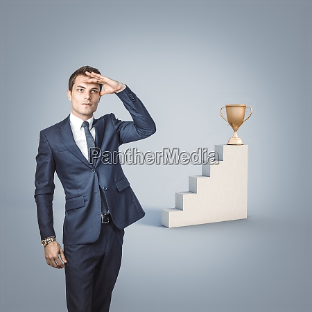 businessman looks away to look for