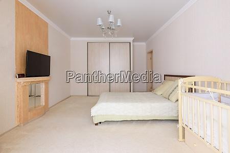 spacious bedroom interior with newborn toddler