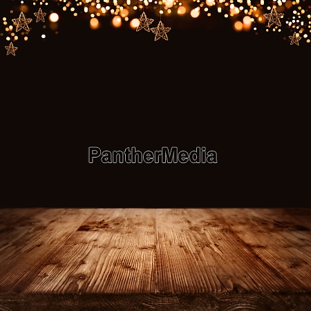 wooden background with christmas stars