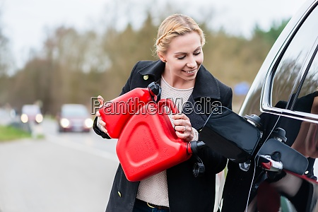 woman filling car up with gas