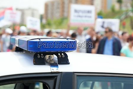 police car flashing lights in focus