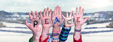 children hands building word peace snowy