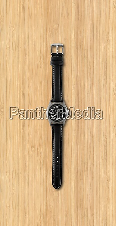 wrist watch isolated on wooden background