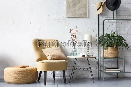 apartment with modern armchairs and cyan