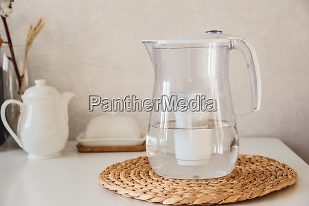 glass and jug with fresh water
