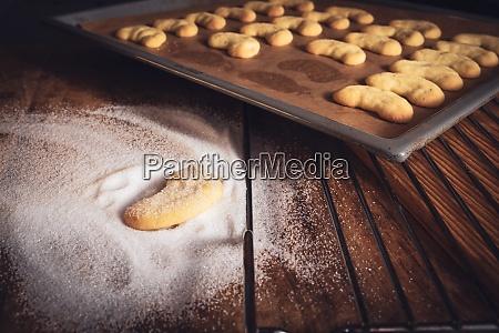 freshly baked vanilla crescents with sugar
