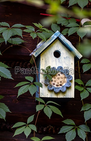 old decorative colorful wooden bird house