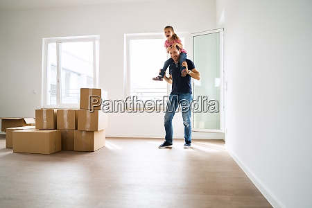 happy people moving into new house