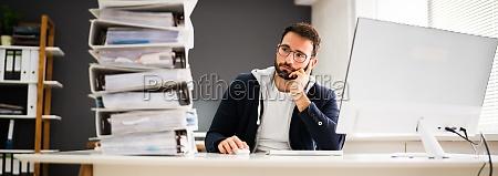 sad professional man in office